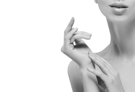 chin on hands: Teeth neck chin hands Beautiful woman portrait face. Isolated on white. black and white. Studio shot.