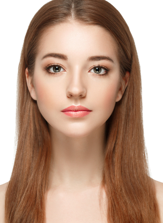 Beautiful woman face close up portrait young. Isolated on white. Studio shot.