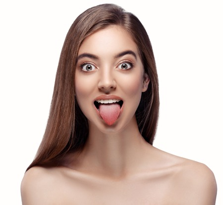 Tongue open mouth Beautiful woman face close up portrait young. Isolated on white.