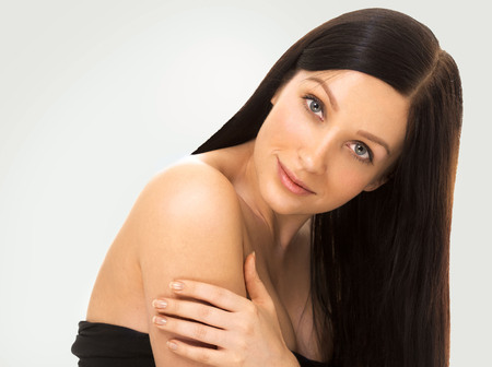 hair studio: Woman with beautiful healthy long hair and skin  young studio portrait. Studio shot. Stock Photo