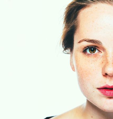 freckle: Woman freckle happy young beautiful studio portrait with healthy skin half. Studio.