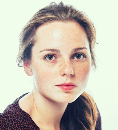 Portrait of young woman with freckles. Isolated on white. Stok Fotoğraf