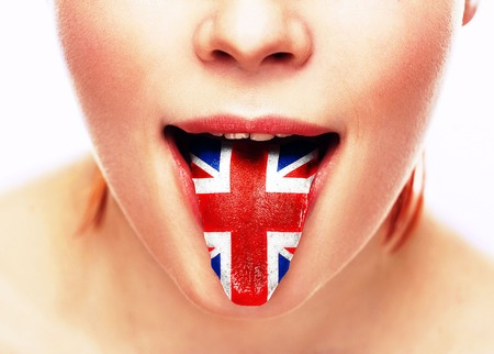 English language tongue open mouth with flag Britain woman face. Studio.