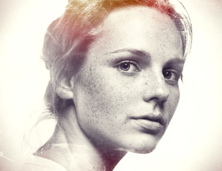 black hair blue eyes: Portrait of young and happy woman with freckles. Black and white.
