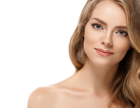 Beauty Woman face Portrait. Beautiful Spa model Girl with Perfect Fresh Clean Skin. Blonde female looking at camera and smiling. Beautiful hairstyle Youth and Skin Care Concept