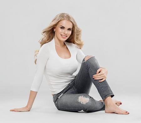 Blonde woman beautiful girl with long hair studio portrait. Studio shot. Stock Photo