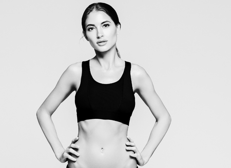 Sport. Woman sport body strong and beautiful black and white. Studio shot.