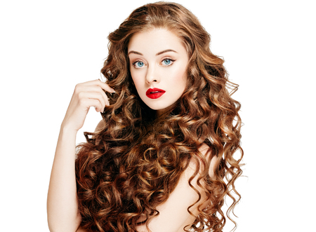 Beautiful people. Curly Hair Red Lipsq. Fashion Girl With Healthy Long Wavy Hair. Beauty Brunette Woman Portrait.Hair Extension, Permed Hair Foto de archivo
