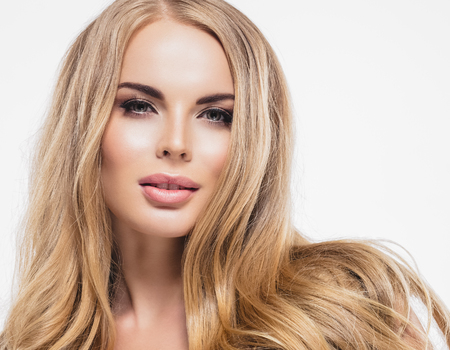 Perfect blonde woman hair beauty portrait. Studio shot. Isolated on white.