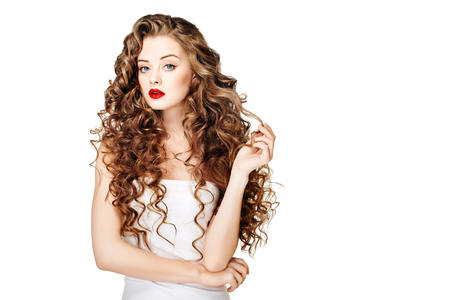 Beautiful people. Curly Hair Red Lipsq. Fashion Girl With Healthy Long Wavy Hair. Beauty Brunette Woman Portrait.Hair Extension, Permed Hair Archivio Fotografico