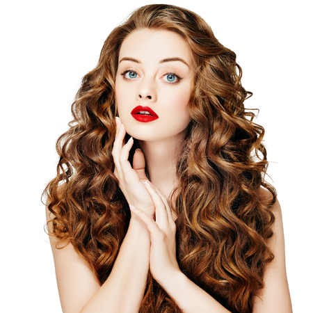 Beautiful people. Curly Hair Red Lipsq. Fashion Girl With Healthy Long Wavy Hair. Beauty Brunette Woman Portrait.Hair Extension, Permed Hair Banco de Imagens