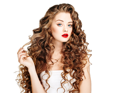 Beautiful people. Curly Hair Red Lipsq. Fashion Girl With Healthy Long Wavy Hair. Beauty Brunette Woman Portrait.Hair Extension, Permed Hair Stockfoto