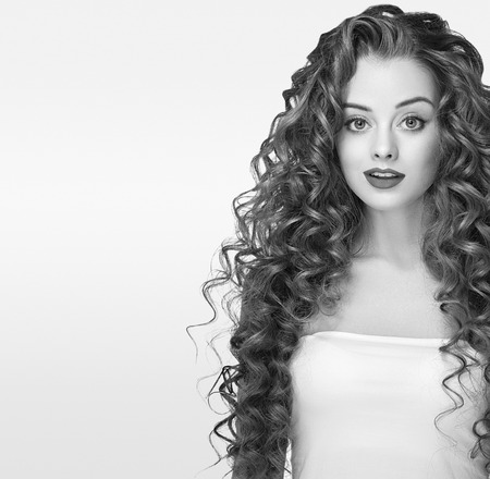 Beautiful people Woman. Curly Hair. Fashion Girl With Healthy Long Wavy Hair. Beauty Brunette Woman Portrait.Hair Extension, Permed Hair Black and White Stock Photo