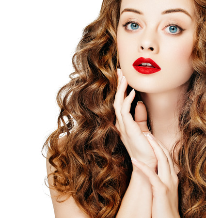 Beautiful people. Curly Hair Red Lipsq. Fashion Girl With Healthy Long Wavy Hair. Beauty Brunette Woman Portrait.Hair Extension, Permed Hair Stock Photo