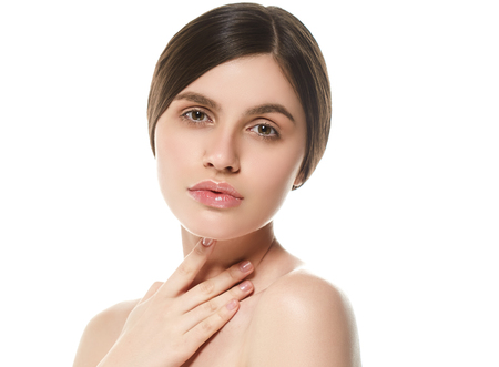 Beautiful Woman Face Portrait Beauty Skin Care Concept Beautiful beauty young female model girl touching her face skin cheeks hands fingers. Fashion Beauty Model isolated on white Reklamní fotografie