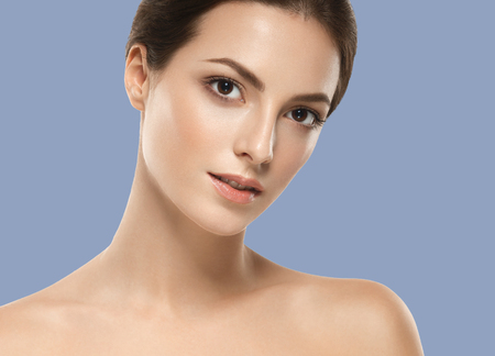 Woman cosmetic closeup beauty portrait, for salon beautiful people and healthy care skin and hair over blue color background
