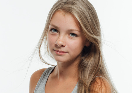 Cute teenage girl freckles woman face closeup portrait with healthy skin. Studio shot. Stock Photo