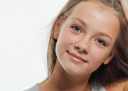 Cute teenage girl freckles woman face closeup portrait with healthy skin Stock Photo