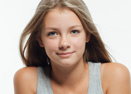 Cute teenage girl freckles woman face closeup portrait with healthy skin. Studio shot. Stock fotó
