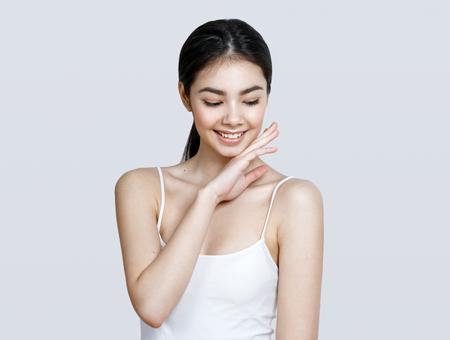 Asian woman girl beauty portrait. Studio shot. Gray background. Stock Photo - 79426795