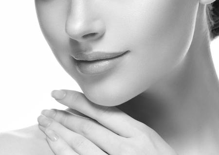 Woman lips cosmetic monochrome  neck chin and ceeks beauty. Studio shot. Banco de Imagens