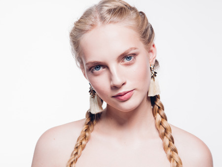 Woman with pigtails beauty healthy skin isolated on white blonde female. Studio shot. Foto de archivo