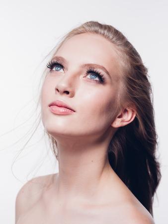 Eyelashes woman eyes face close up with beautiful long lashes isolated on white. Studio shot. Foto de archivo
