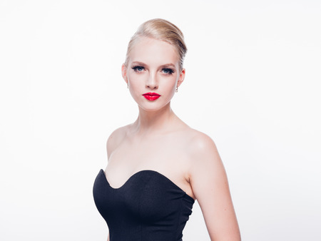 Beautiful blonde woman with red lipstick and classic fashion style isolated on white female beauty. Studio shot.