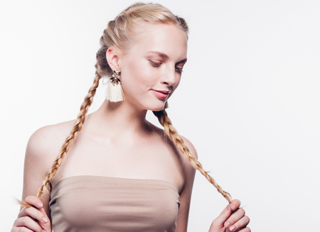 Woman with pigtails beauty healthy skin isolated on white blonde female. Studio shot. Stock Photo
