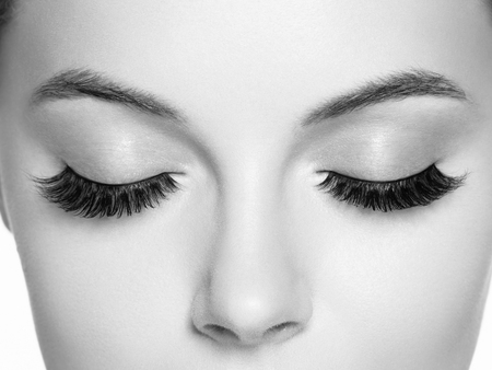Eye lashes, lash extension woman  lashes close up macro monochrome. Studio shot. Stok Fotoğraf