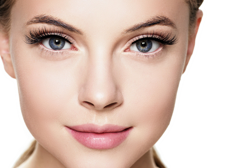 Beautiful woman face with eyelashes beauty healthy skin natural makeup. Studio shot.