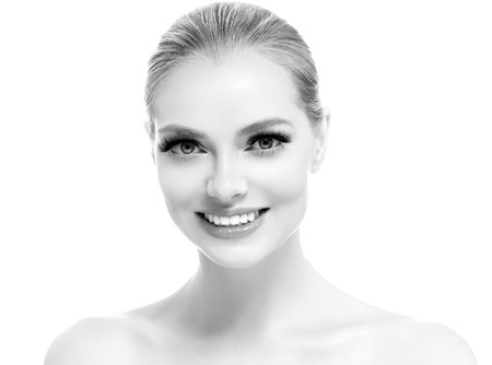 Healthy teeth smile woman beautiful face close up monochrome. Studio shot. 스톡 콘텐츠