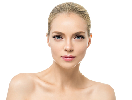 Beautiful woman with healthy skin natural makeup blonde hair beauty face with beauty lashes and pink lips. Studio shot.