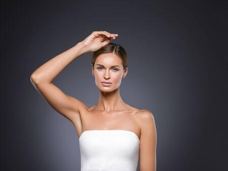Armpits woman hands up beauty. Studio shot. Standard-Bild
