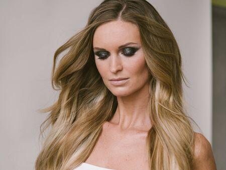 Beautiful woman long hair blonde natural portrait with beauty makeup. Studio shot.