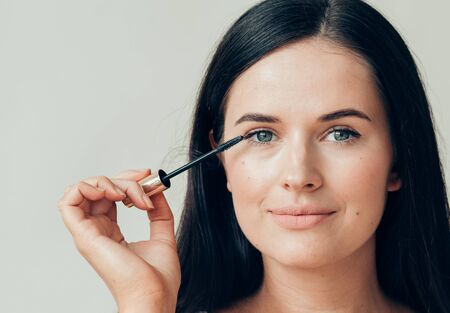 Woman makeup mascara eyes healthy skin natural fashion makeup. Studio shot.