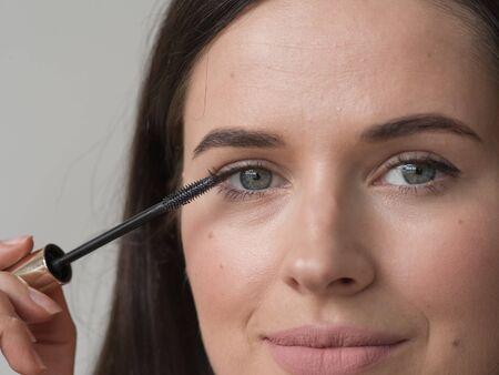 Woman makeup mascara eyes healthy skin natural fashion makeup. Studio shot. Standard-Bild