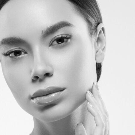 Asia beauty woman healthy skin face clean fresh skin spa. Studio shot. Monochrome. Gray. Black and white.