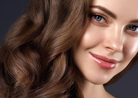 Beauty hair woman curly hairstyle natural makeup. Studio shot.