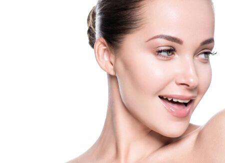 Woman beauty face healthy skin natural makeup beautiful young model. Studio shot. Standard-Bild