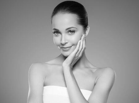 Skin care woman beauty face healthy face skin cosmetic model emotional andhappy. Studio shot.  Monochrome. Gray. Black and white.