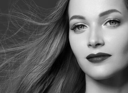 Beautiful hair woman healthy beauty hairstyle model. Studio shot. Monochrome. Gray. Black and white. Фото со стока