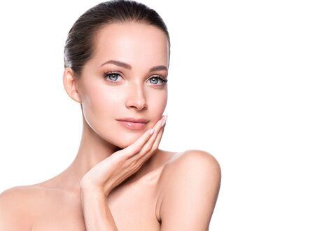 Woman beauty face healthy skin natural makeup beautiful young model. Studio shot.