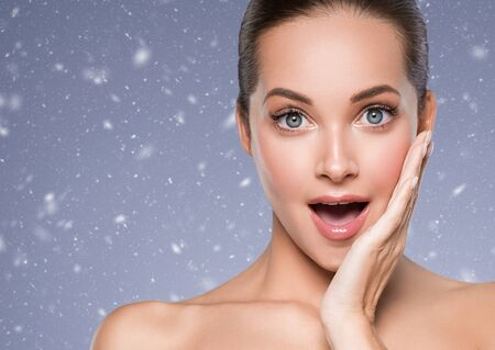 Winter Skin care woman beauty face healthy face skin cosmetic model emotional andhappy. Studio shot. Фото со стока