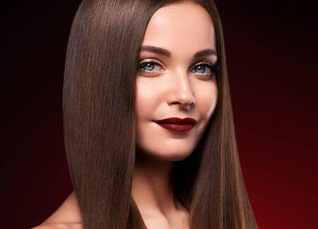 Beautiful hair woman long smooth brunette hairstyle beauty healthy hair female model portrait.  Studio shot.