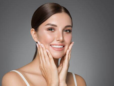Beauty woman healthy teeth smile healthy beautiful skin model face skin care happy female Фото со стока