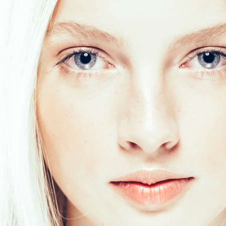 Close up face woman with beauty skin and beautful blond hair isolated on white. Studio shot.