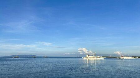 Monochrome beautiful landscape of blue sky,calm sea.Boats drift in ocean.Sun day