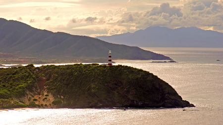 Lighthouse in Punta Zaragoza Hill at Playa Puerto Cruz Beach, Isla Margarita, Venezuela photo