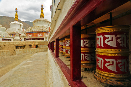 gompa: Buddhist Prayer Wheels Stock Photo